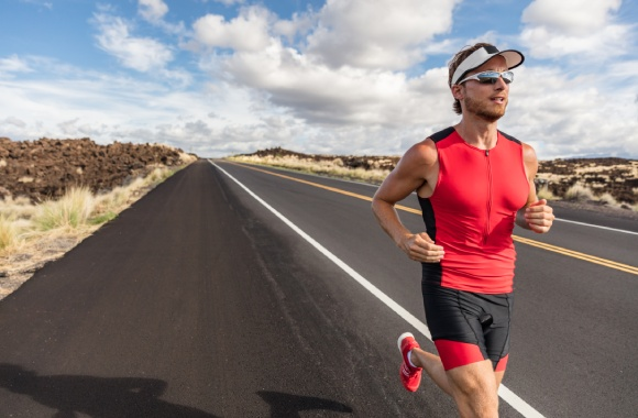 Man running outdoors with sports glasses